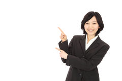 Young asian woman pointing Royalty Free Stock Photo