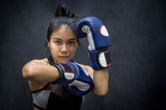 Young Asian woman posing with boxing gloves Royalty Free Stock Photos