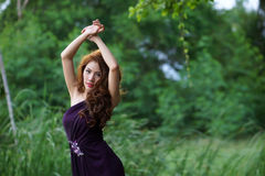 Young Asian woman posing in greenery background Stock Photos