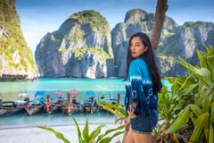 Young asian woman posting on the Maya bay stock photos