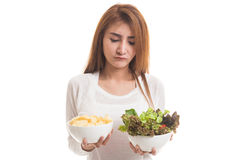 Young Asian woman with potato chips and salad. Stock Image