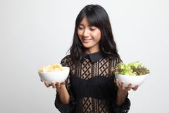Young Asian woman with potato chips and salad. On white background stock image