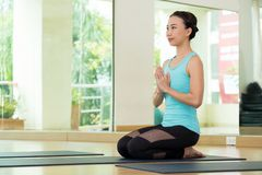 Young asian woman practicing yoga meditation, healthy lifestyle, wellness, well being royalty free stock photography