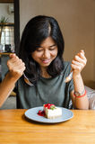 Young asian woman prepare to eating a cake royalty free stock image