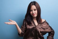Young Asian woman present with her hand. Stock Images