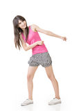 Young asian woman pulls an imaginary rope Stock Photo