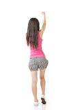 Young asian woman pulls an imaginary rope Stock Image