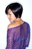 Young Asian woman in purple knitted cardigan. Royalty Free Stock Image