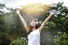 Young asian woman raise her hand up. To resting after workout session Stock Photos