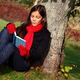 Young asian woman reading book Stock Photo