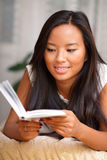 Young asian woman reading a book Royalty Free Stock Photography