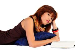 Young asian woman reading a book Royalty Free Stock Image