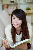 Young asian woman reading book Stock Photography