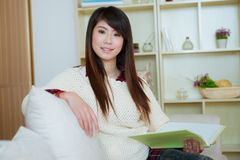 Young asian woman reading book Royalty Free Stock Photos