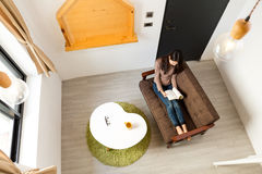Young asian woman reading book at home Stock Image