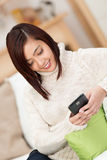 Young Asian woman reading a text message Stock Images