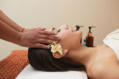 Young asian woman receiving head massage at beauty spa royalty free stock image