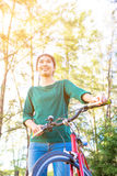 Young asian woman with red bicycle Royalty Free Stock Image