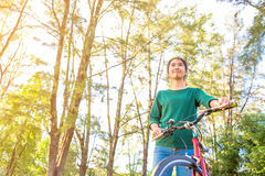 Young asian woman with red bicycle Royalty Free Stock Images