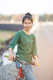 Young asian woman with red bicycle Royalty Free Stock Photos