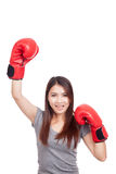 Young Asian woman with red boxing glove Royalty Free Stock Photography