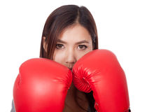 Young Asian woman with red boxing glove Royalty Free Stock Images