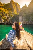 Young asian woman relax on long tail boat at Maya bay stock images