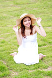 Young Asian Woman relaxing on the green grass Stock Images