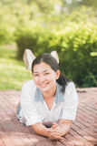 Young asian woman relaxing looking happy and smiling Royalty Free Stock Photo