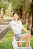 Young asian woman relaxing looking happy and smiling Royalty Free Stock Photography