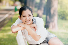Young asian woman relaxing looking happy and smiling Stock Images