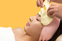 Young asian woman removing facial peel off mask stock photo