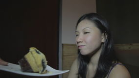 Young asian woman resists to sweet cake keeps her diet stock video