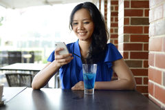 Young asian woman at restaurant Stock Image