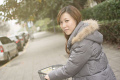 Young Asian woman riding bicycle Stock Image