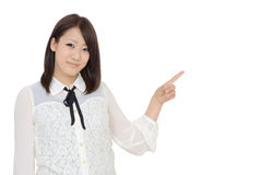 Young asian woman rise hand and pointing royalty free stock photos