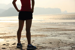 Young asian woman runner on beach Royalty Free Stock Photography