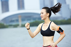 Young asian woman running by a lake stock image