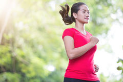 Young asian woman running at the park Royalty Free Stock Images