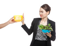 Young Asian woman with salad say no to potato chips Royalty Free Stock Photo