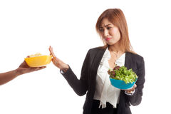 Young Asian woman with salad say no to potato chips Stock Photos
