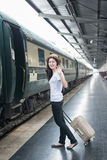 Young Asian woman say goodbye to boyfriend at train station befo Royalty Free Stock Image