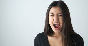Angry woman screaming out loud stock video