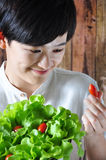Young Asian Woman Selected Fresh Tomato Royalty Free Stock Images