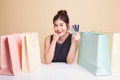 Young Asian woman with shopping bag and blank card. Royalty Free Stock Image