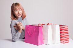 Young Asian woman with shopping bag and blank card. Stock Photo