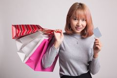 Young Asian woman with shopping bag and blank card. Royalty Free Stock Photo