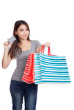 Young Asian woman with shopping bag and blank card Royalty Free Stock Image
