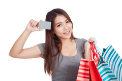 Young Asian woman with shopping bag and blank card Royalty Free Stock Images