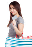 Young Asian woman with shopping bag and blank card Stock Photography